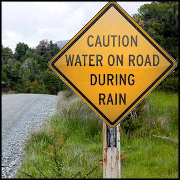 Flooded Road Caution Sign
